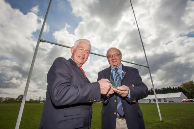 Crewe Guardian: John Owen, RFU immediate past president, right, presents the award to Robin Astra, chairman of Sandbach RUFC