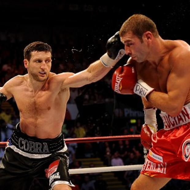 Carl Froch (left) will have a rematch with Lucian Bute next year