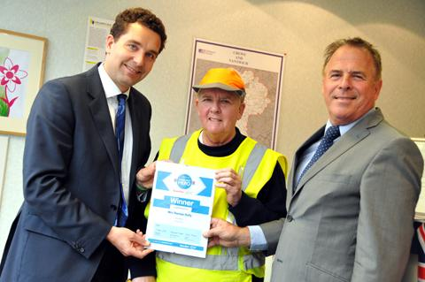 MP Edward Timpson and eZe-Talk's Steve Walsh congratulate Theresa Reilly
