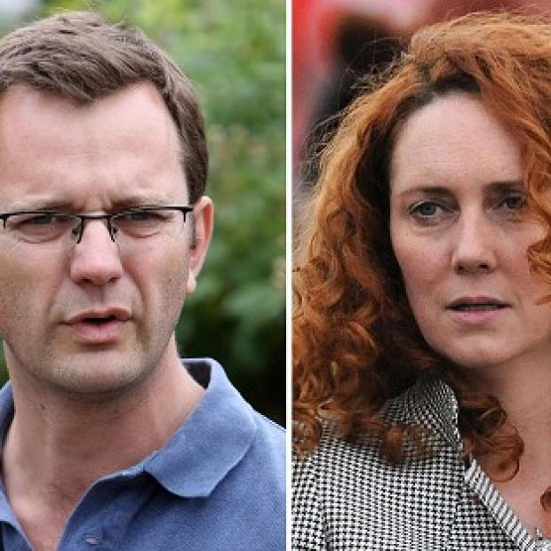 Andy Coulson and Rebekah Brooks are among eight people charged over phone hacking