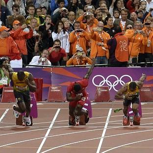 A bottle lands on the track after being thrown from the crowd as the men's 100 metres final begins (AP/Martin Meissner)