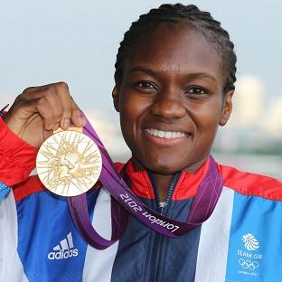 Great Britain's Nicola Adams with her gold medal after her fight with China's Ren Cancan