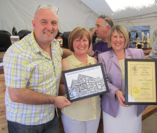 Owners James and Elizabeth are congratulated by MP Fiona Bruce