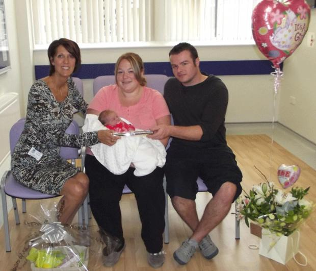 Above, Pam Cornwall, head of midwifery, with Izabella and proud parents Kristie Vernon and Simon Thorley in the unit's new reception area