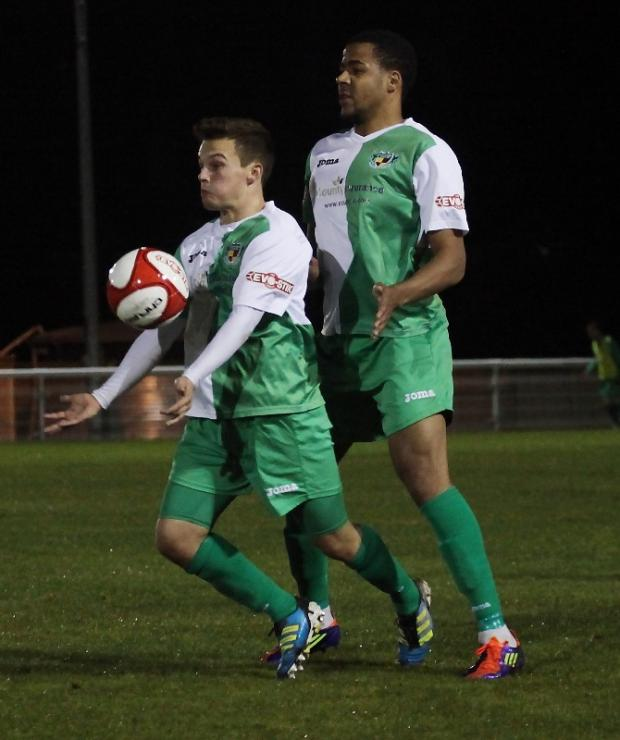 Sean Cooke nicks the ball off goal scorer Christian Smith during Nantwich Town's 1-1 draw with Hednesford. Picture by Simon J Newbury Photography