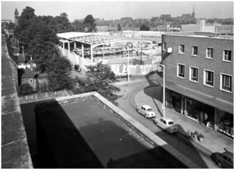 Spring of 1959 shows new shops in Delamere Street while work on the new bus station garage progresses.