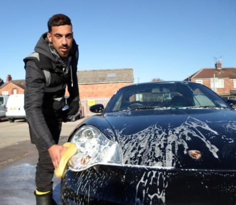 Ade Adeel washes a car to raise money for the One in Eleven appeal