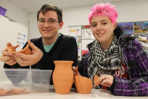 Ellie Matthews, 17, and Ben Braithwaite, 18, piece their pot back together