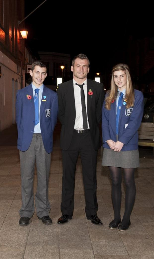 Head Boy John Hillerby and Head Girl Alice Simmons meet Mark Cueto, who was a pupil at the school between 1990-95