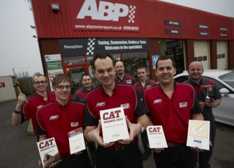 Chris Meredith and staff with ABP's clutch of awards, including its latest accolade for Large Garage of the Year