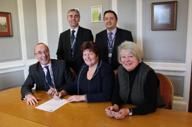Representatives of Reaseheath and Dart sign the merger deal