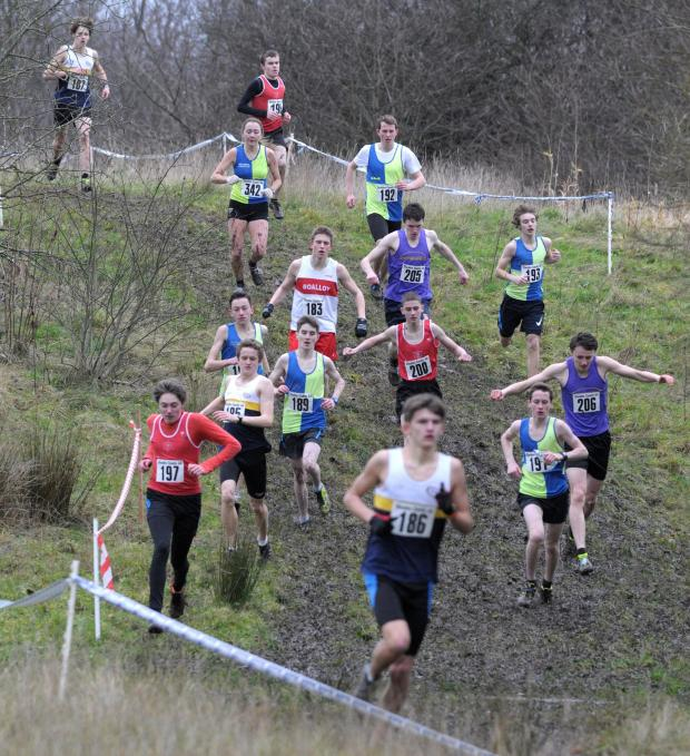Crewe Guardian: Jacob Brown, front, is chased down the hill. He placed sixth in under 17s boys' race