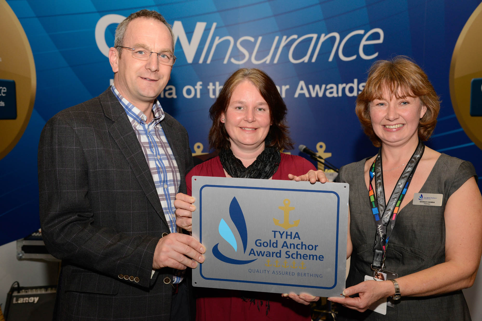 Robert and Andrea Parton receive award from Sarah Treseder CEO RYA FS