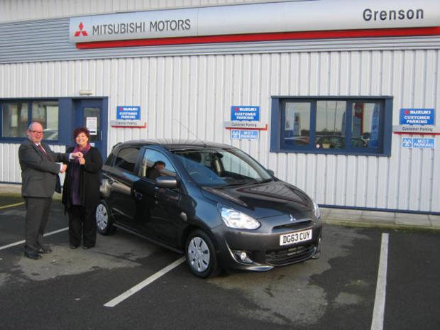 Sean Pattinson dealer principal at Grenson Mitsubishi hands over the keys to Karen Williams of Nantwich