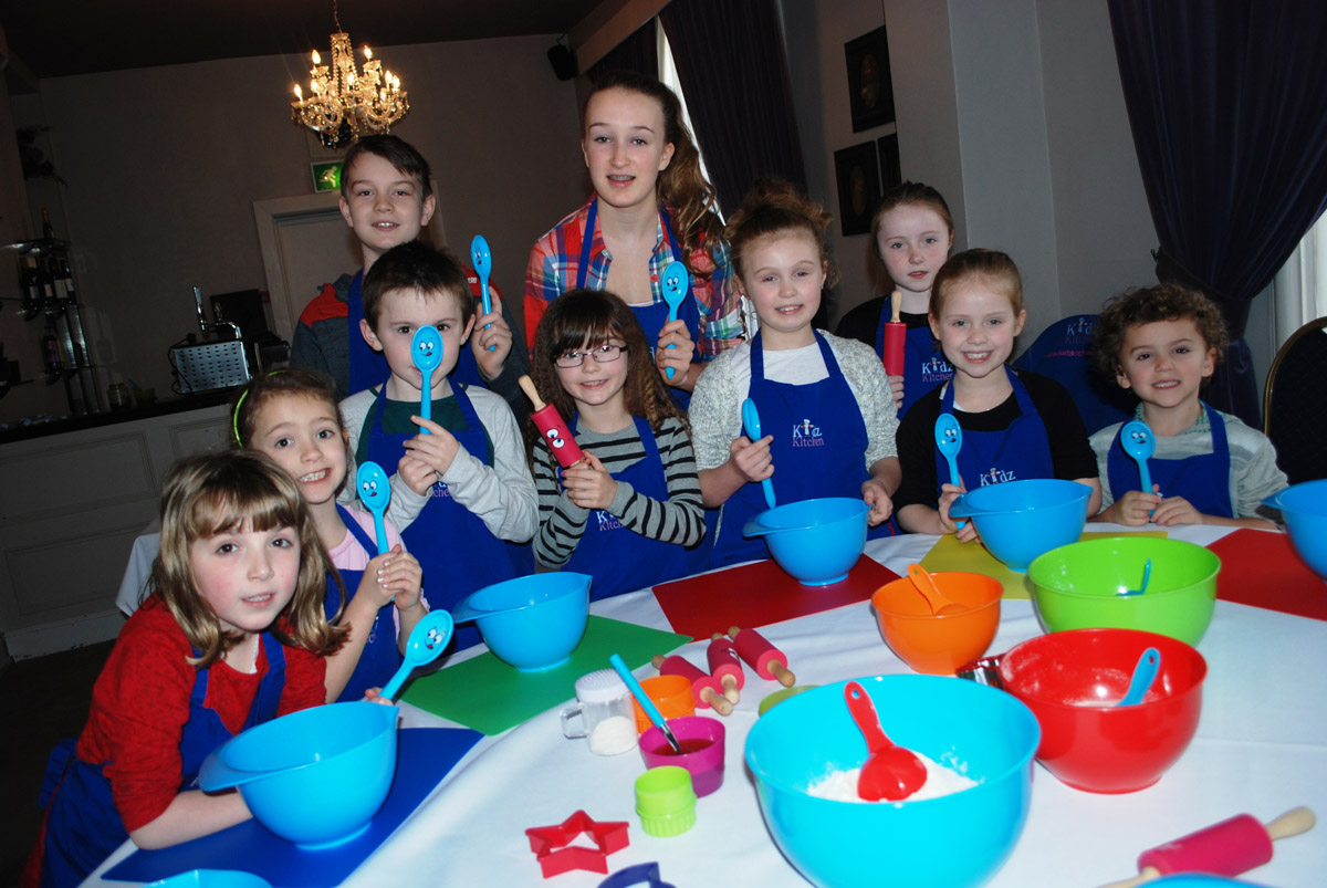 Children have spoons at the ready for a cookery workshop at Residence in Nantwich