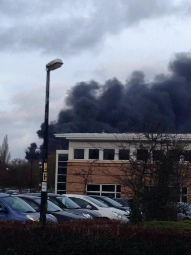 Crewe Guardian: A black plume is rising over Crewe as firefighters tackle the blaze. Send your pict