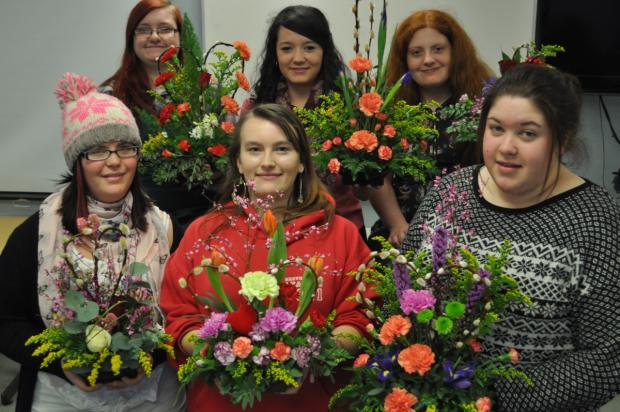 Floristry students (back row) Kiera Woolley, Louise Birks, Aimie McKenna (front row) Zoe Trevitt, Zoe Bloor and Laura Yewdell show off their Valentine designs