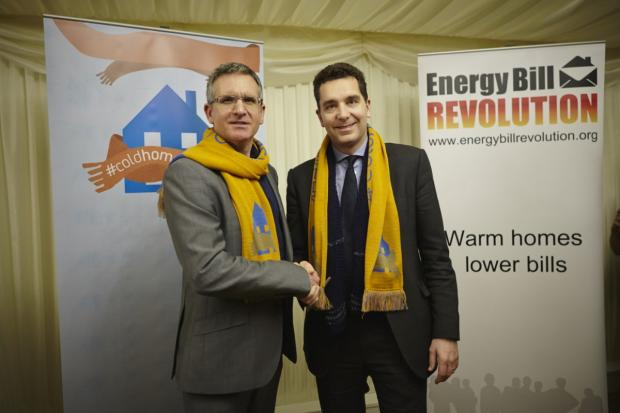 Edward Timpson collects his scarf from campaigner Ed Matthews