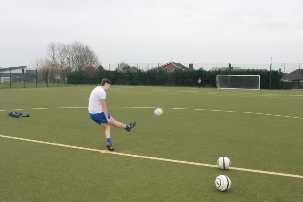 Student Danny Meyler, 17, tries his luck in the crossbar challenge