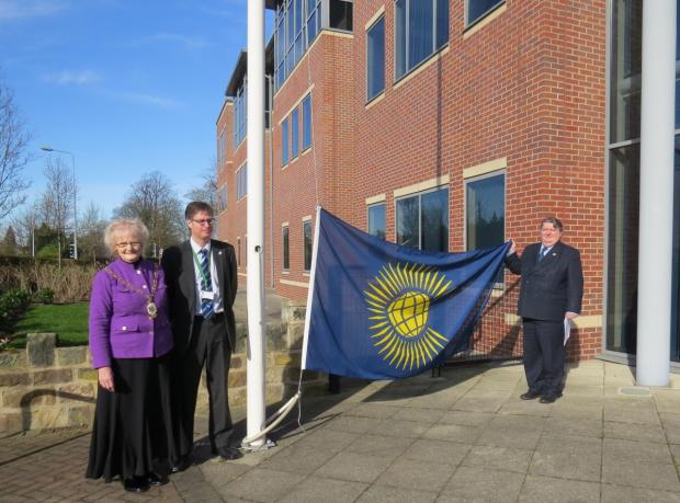 Council Leader, Clr Michael Jones, right, holds the Commonwealth Flag alongside Cheshire East Council chief operating officer Peter Bates, centre, and Cheshire East Mayor Dorothy Flude  at the Commonwealth Fly the Flag Day ceremony at Westfields.