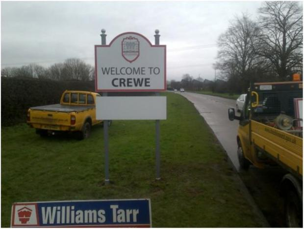 One of fourteen signs placed on roads into Crewe by the town council