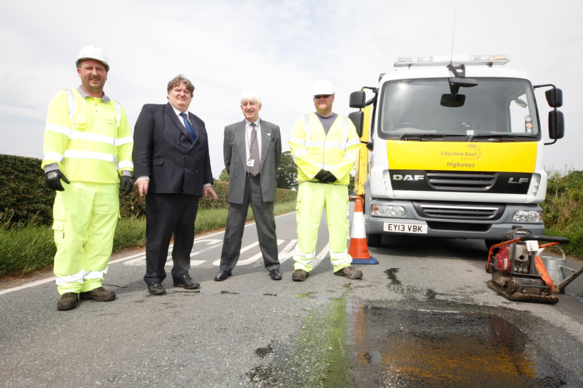 Council Leader Michael Jones (second left) and Cabinet member Councillor David Topping (second from right) with members of the highways maintenance team