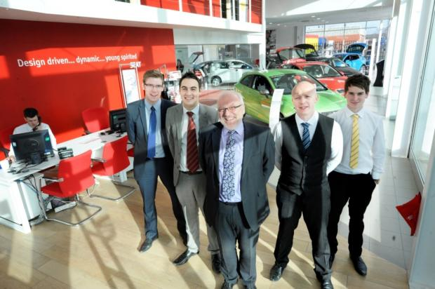 Andrew Barnes is pictured in the foreground with his new sales team, from left: James Bateman, Josh Fallows, John Hulse and Josh Dony at the new showroom at SEAT Crewe