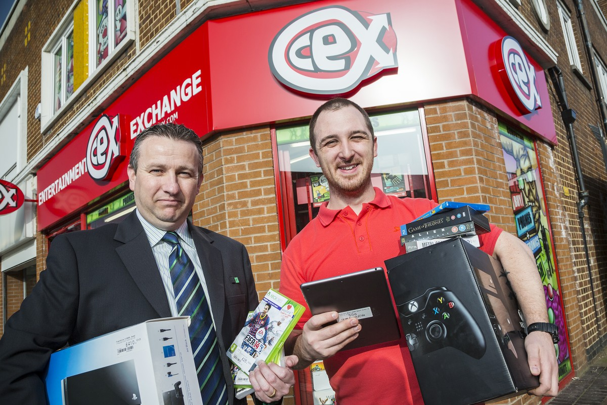 Ben Sweeting, right, has opened a new CeX store in Crewe with help from Neil Smith, left, and Crewe's Lloyds Commercial Banking team.