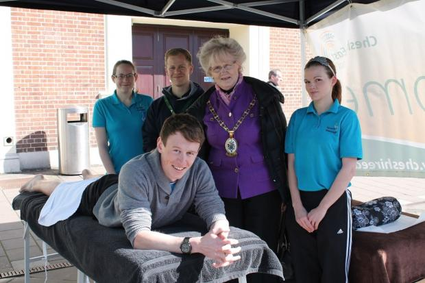 Crewe Mayor Cllr Dorothy Flude with Sports Massage students (l-r) Katie Hebberd, 28, Lee Malkin, 28, Emma Gwynne, 23, and Ewen Macrury, 20, (front) at the Walk the Walk event.