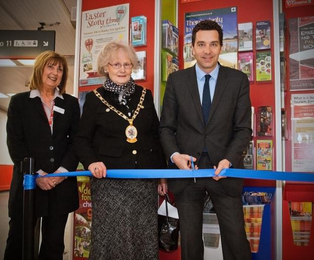 MP Edward Simpson cuts a ribbon to open the information point, watched by Crewe Station manager Sheila Breeze, left, and Cheshire East mayor Cllr Dorothy Flude.