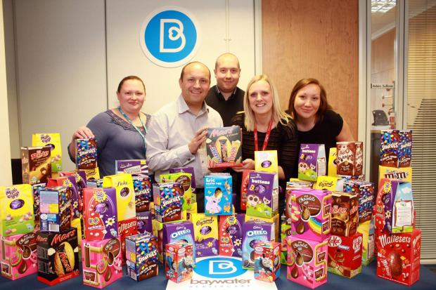 Staff from Baywater Healthcare in Crewe with the eggs they donated to Hope House.