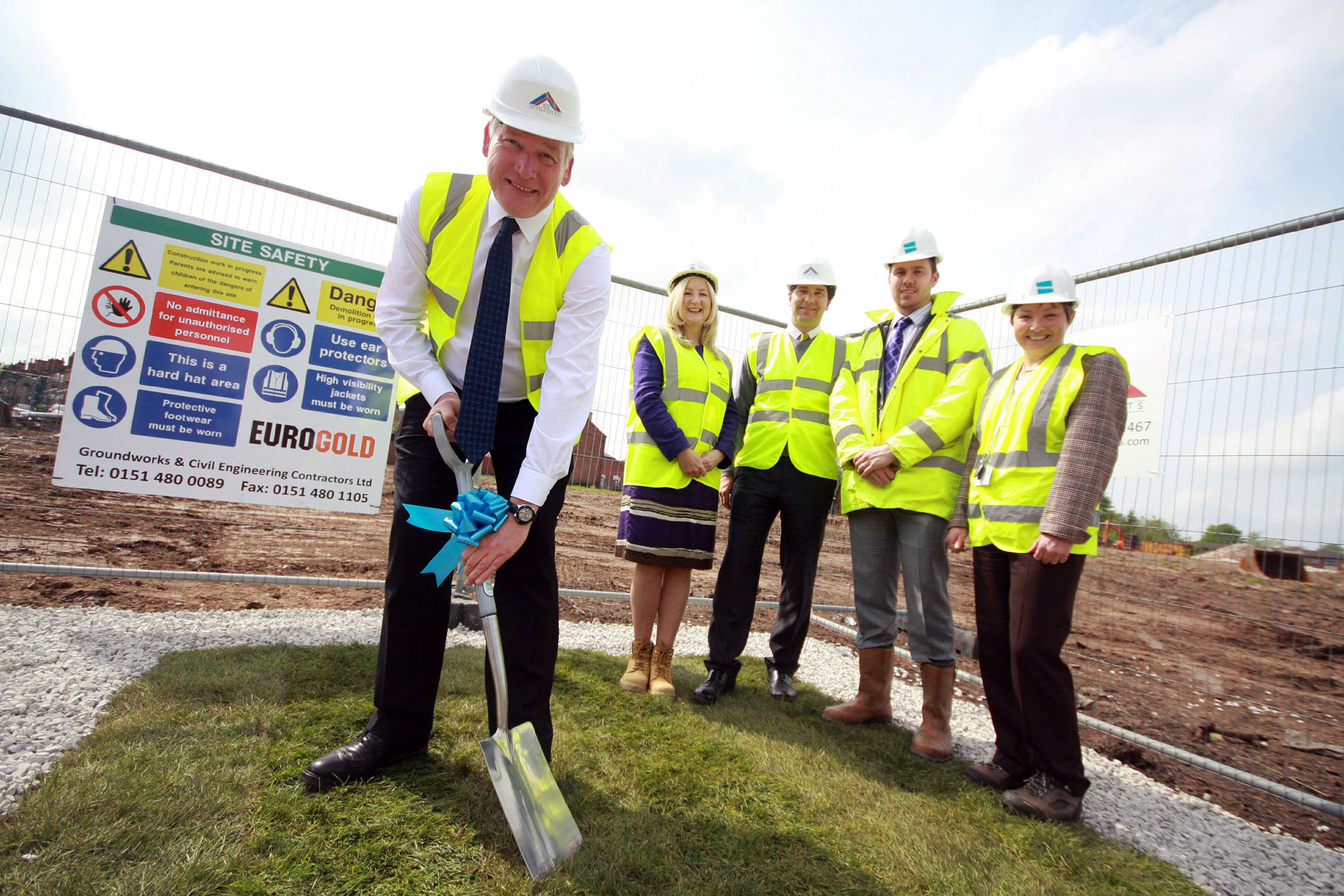 Housing Minister Kris Hopkins digs in, watched on by Deborah McLaughlin, homes and communities executive director north west, MP for Crewe and Nantwich Edward Timpson, Kevin Williams, Wulvern executive director and Wulvern Chief Executive Sue Lock