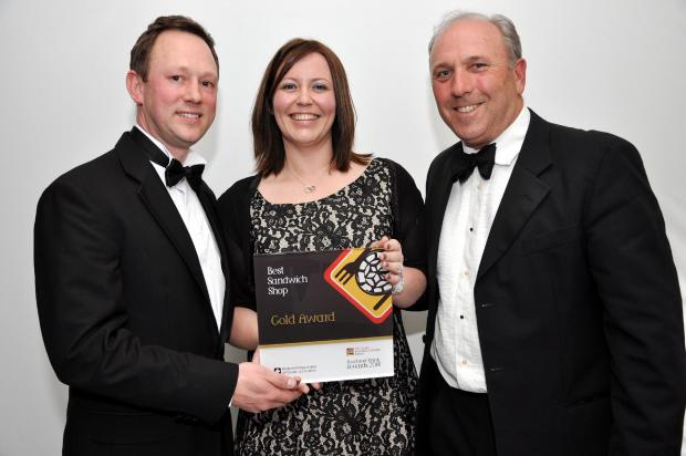 Sarah Roberts, owner of Bloom, picks up her award