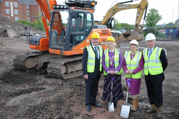 From left, Clr Don Stockton from Cheshire East Council, Clr Dorothy Flude, Mayor of Cheshire East, Kathy Cowell, chair of Your Housing Group, Philip Whitehead, regional regeneration manager at Countryside Properties.
