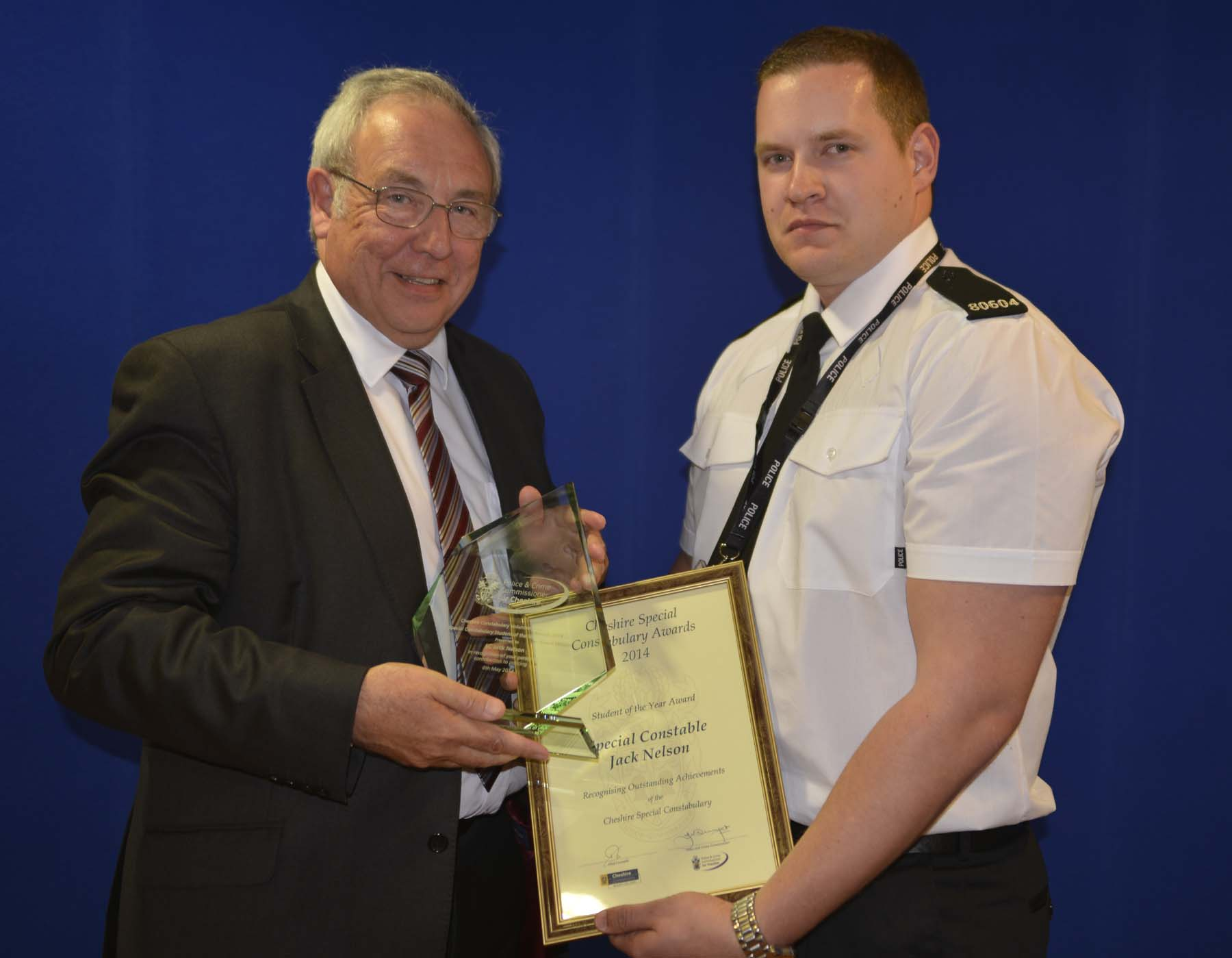 John Dwyer, Police and Crime Commissioner for Cheshire, presents Jack Nelson with his award.