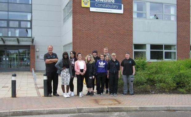 Public Services Lecturer Nigel Bailey, far left, with Public Services students outside the police headquarters.