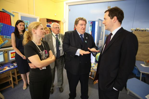 Crewe Guardian: Clr Michael Jones and George Osborne at Peover Superior Primary School on Friday