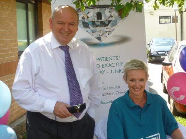 Hospital Executive Director Wyn Davies and hospital receptionist  Alison Hughes before the head shave