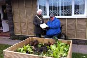 From left, Crewe Mayor, Pam Minshull and local grower John McGinlay with the award from the RHS