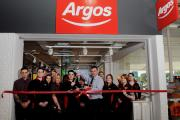 Sainsbury's store manager Ian Sutton cuts the ribbon with Argos manager Paul Willott at the opening of the new Argos Digital store