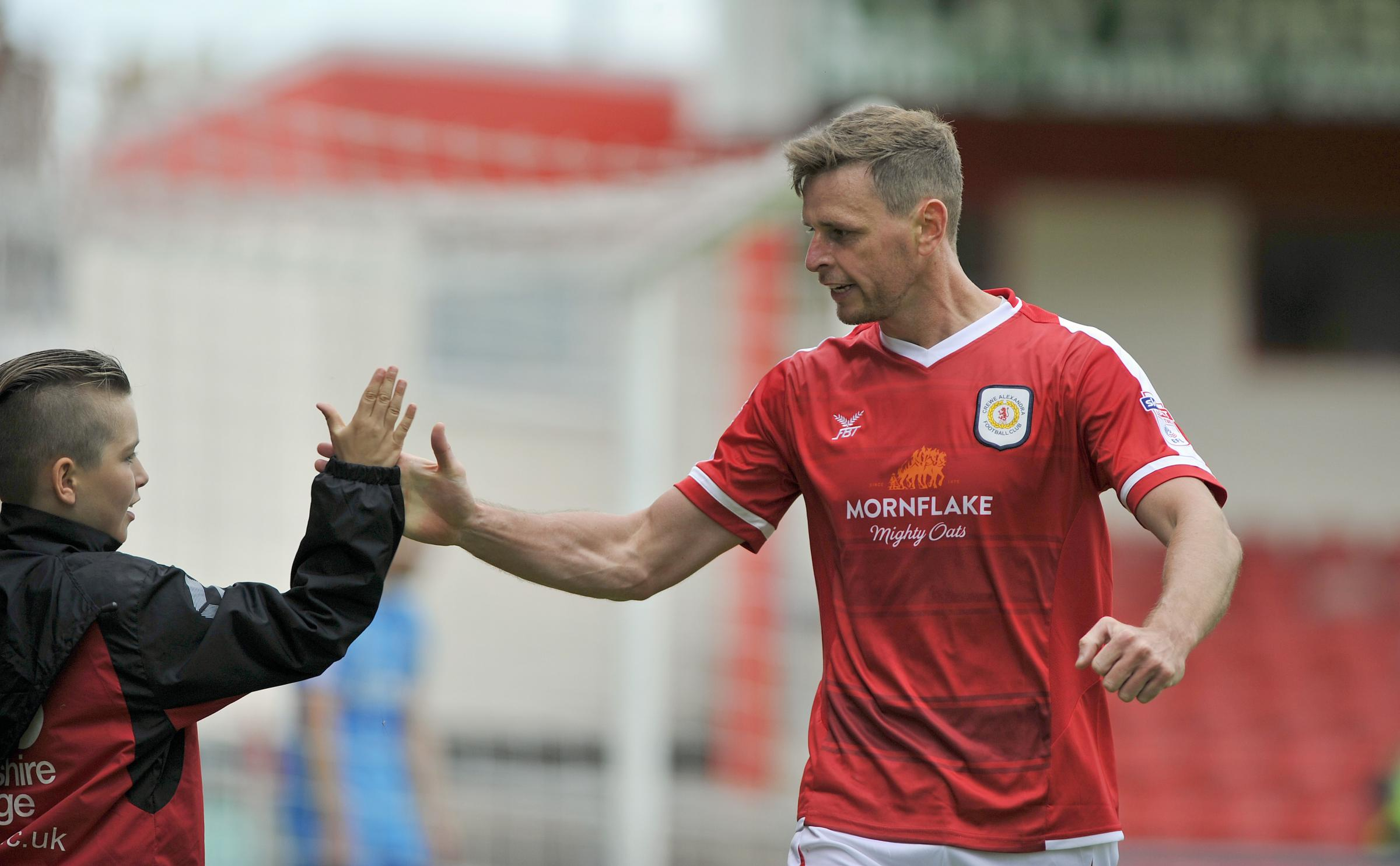 Chris Porter is congratulated by a fan after scoring Crewe's winner against Barnet on Saturday. Picture by Steve Finch