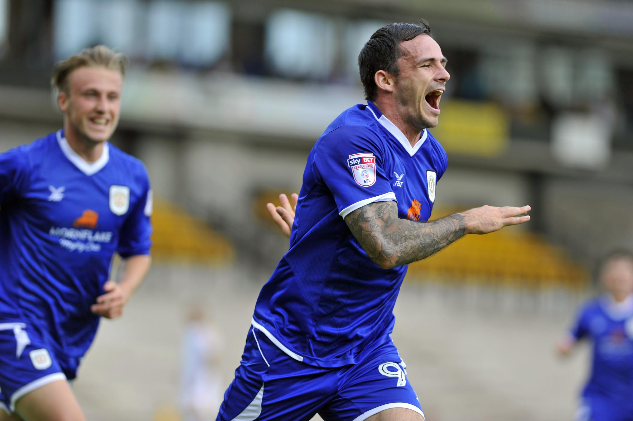 Chris Dagnall is delighted by scoring Crewe's winner at Port Vale. Picture by Steve Finch