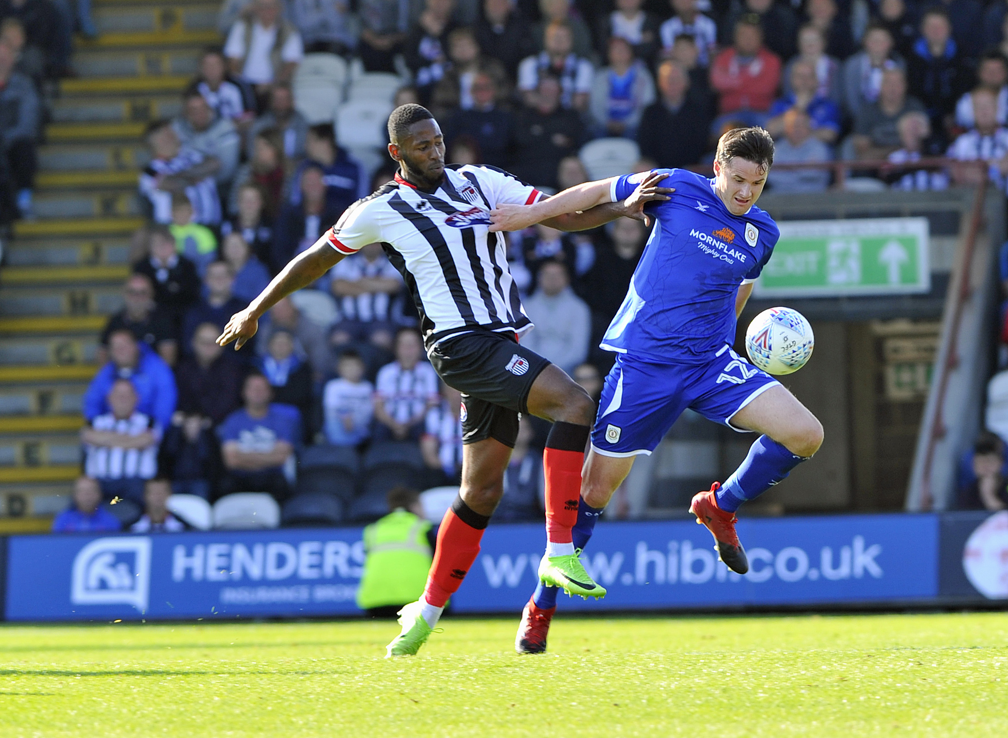 Crewe defender Eddie Nolan battles for possession with Grimsby striker Jamile Matt. Picture by Steve Finch