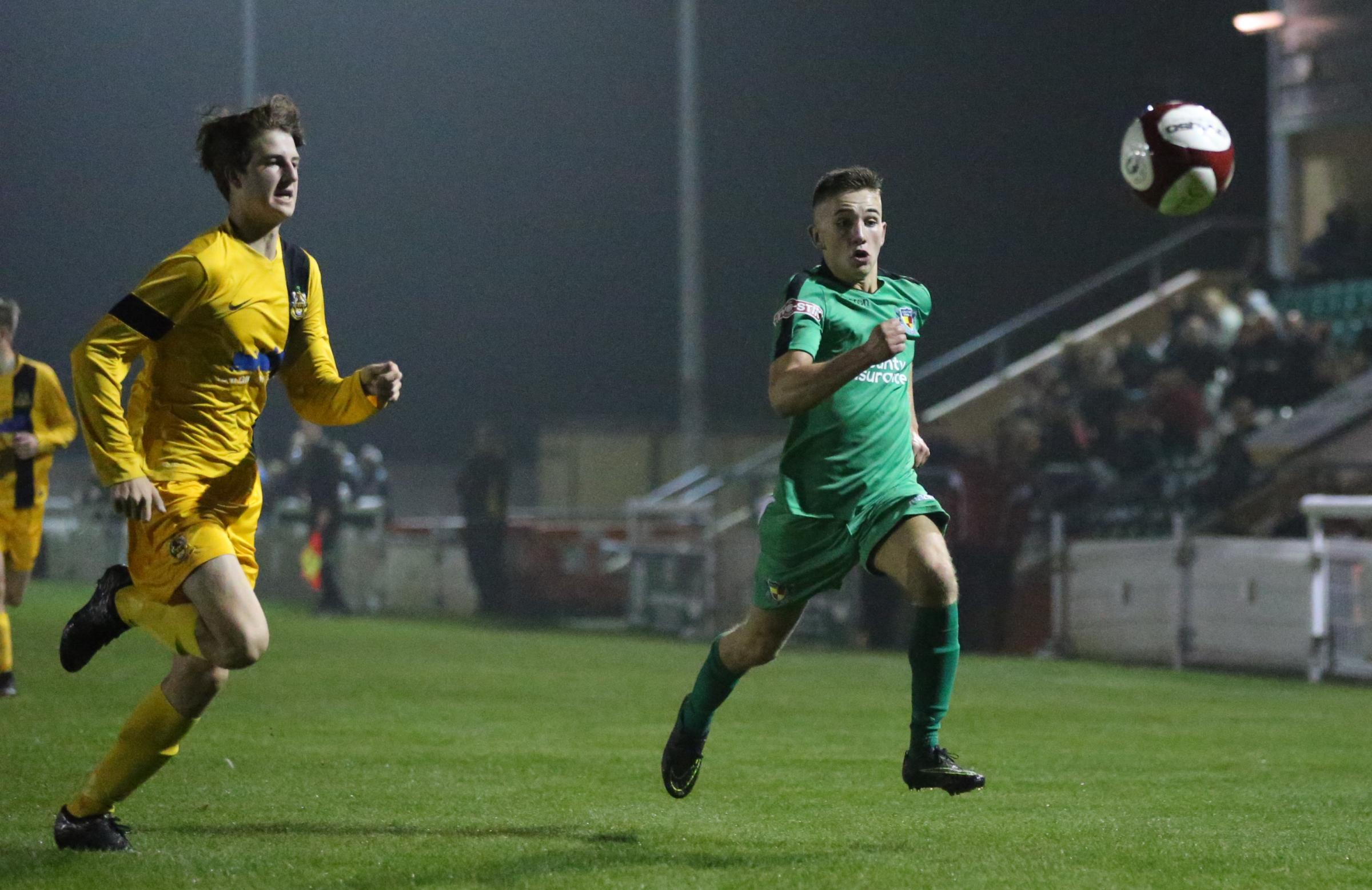 Jake Davies chases the ball for Nantwich's youth team in their FA Youth Cup win over Southport. Picture by Jonathan White