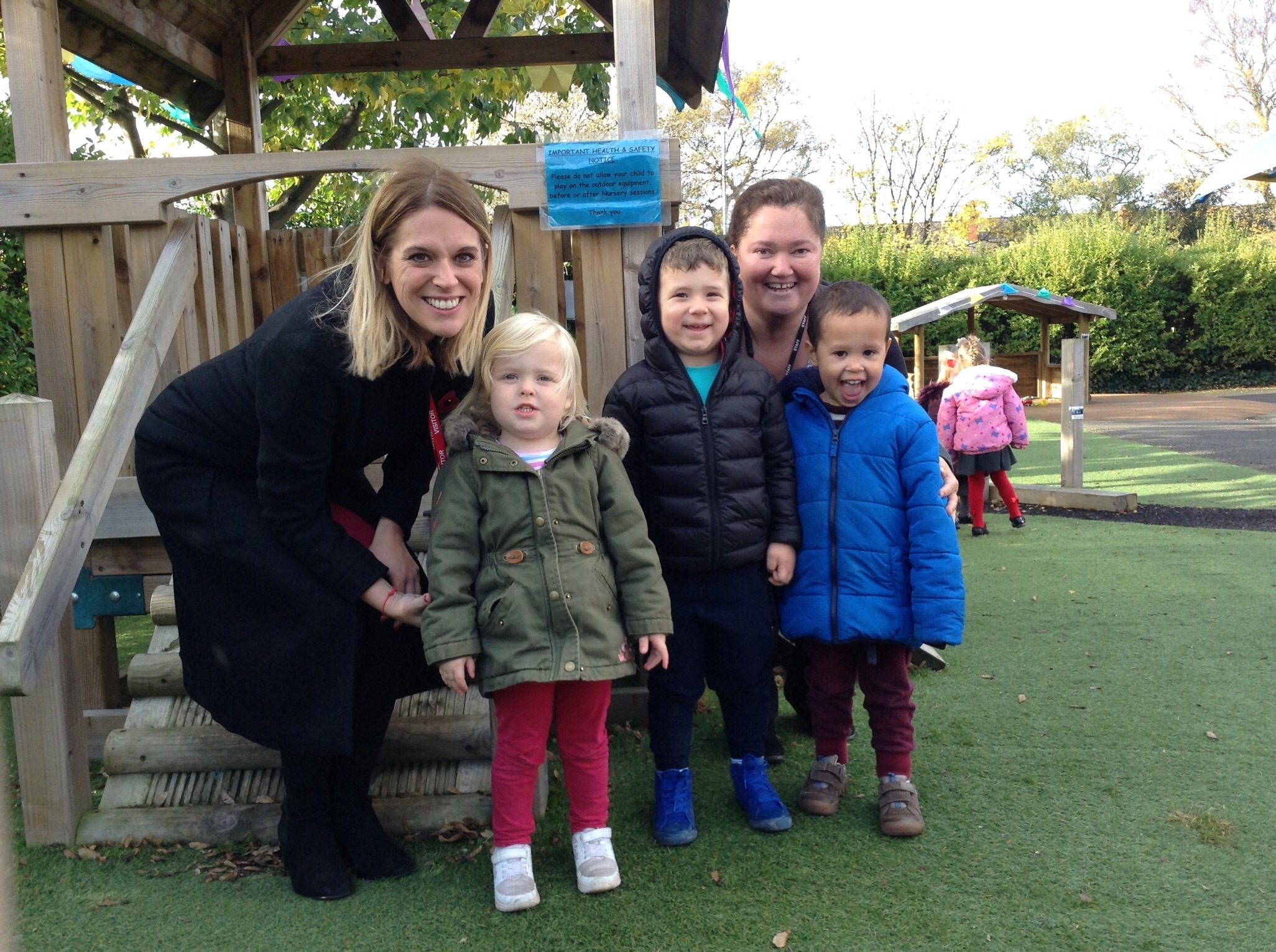 Laura Smith, MP for Crewe and Nantiwich, with head teacher Elizabeth Hulse and children from Westminster Nursery School