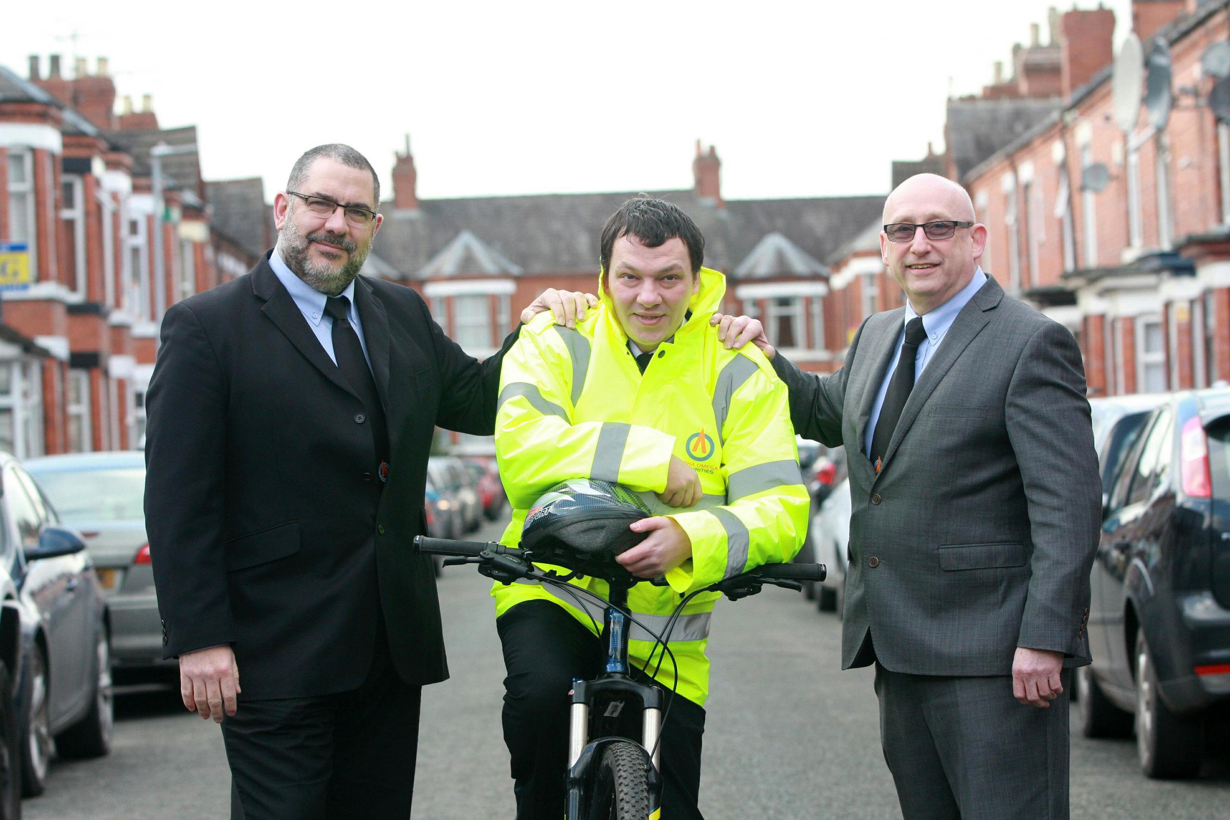 Alpha Omega managing director Ken Lawton (right) with new Operations Director Andy Taylor and security guard Andre Smith who has signed up to the bike scheme