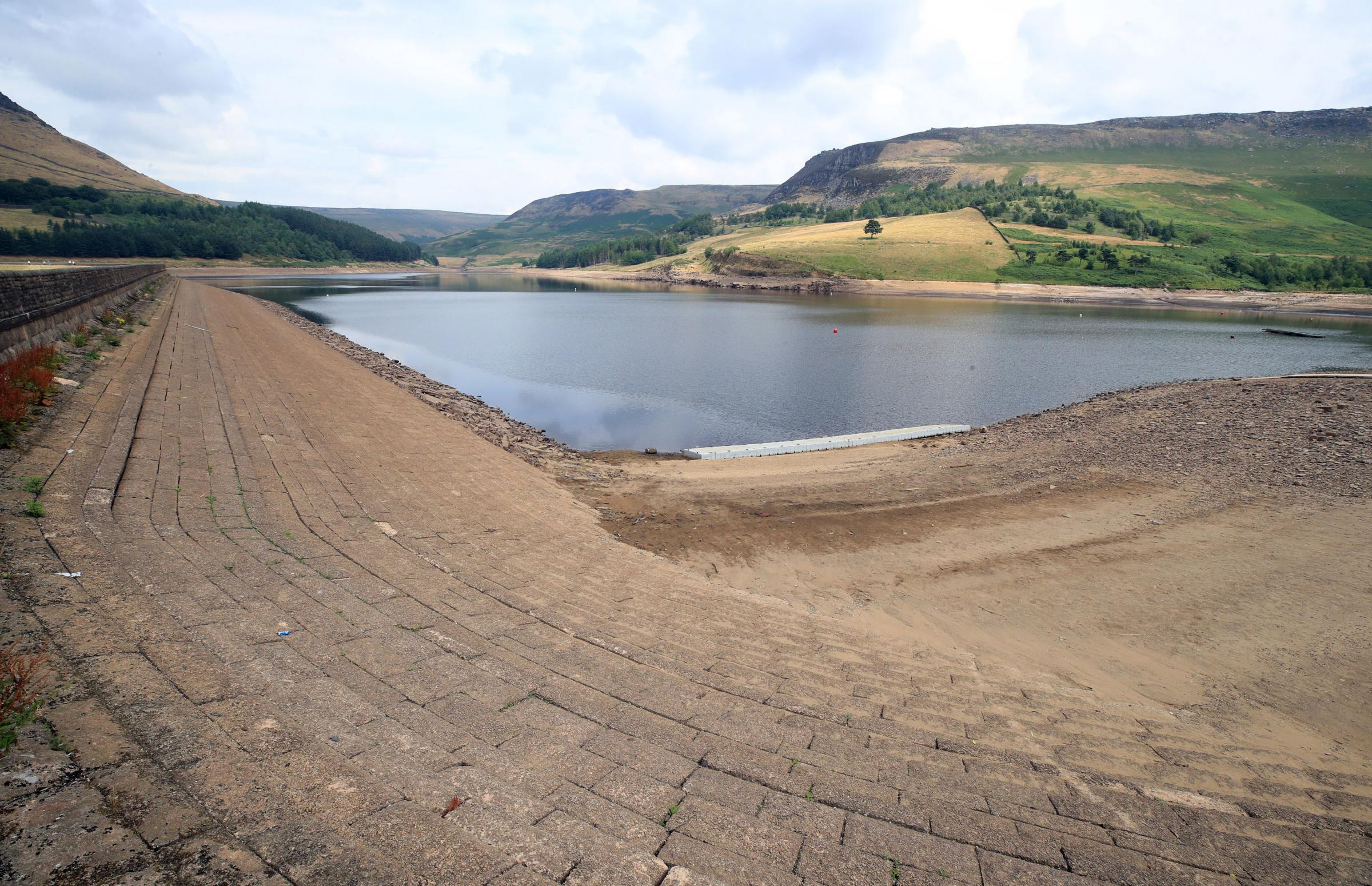 Low water levels on Dove Stone Reservoir on Saddleworth Moor near Oldham as millions of people are facing a hosepipe ban, water company United Utilities has announced. Peter Byrne/PA Wire