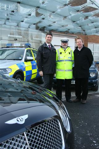 NEW TECHNOLOGY: Ulrich Eichhorn with PC Bob Brittan and Tim Oakes at the Crewe car plant.